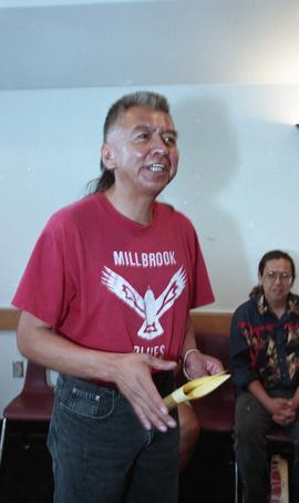 First Nations man holding paper and speaking during First Nation s graduation