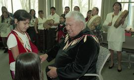 BCIT open house '98, First Nations elder talking with First Nations children [1 of 2 photographs]