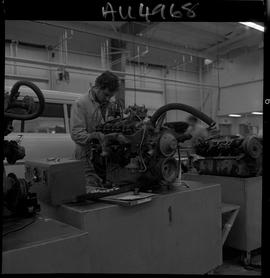 B.C. Vocational School image of an Automotive Mechanics program student working on a vehicle engi...