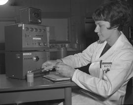 Medical isotope option, Health technology, 1968; a student testing radioactive material in a comp...