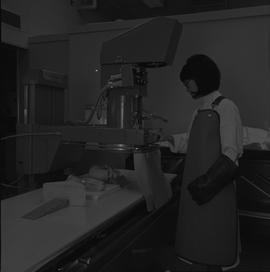 Medical radiography, 1968; woman in radiation protective gear x-raying a skull [1 of 2]