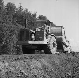 Logging, 1969; a man driving a Caterpillar dozer