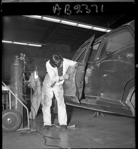 BC Vocational School image of Autobody program students working on a vehicle in the shop [7 of 8 ...