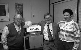 Applied Technology Training Centre staff members (?) posed with boxes [2 of 3 photographs]