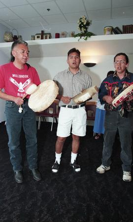 Three First Nations men playing instruments at the First Nations graduation [2 of 3 photographs]