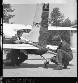 BC Vocational School image of Aeronautics students working on a small aircraft outside the hangar...