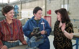 BCIT women in trades; aviation, students in uniforms using aviation tools and equipment inside a ...