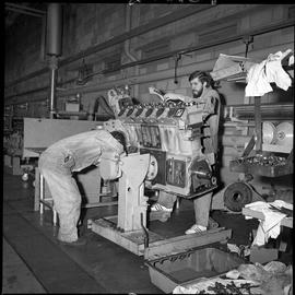 BC Vocational School Diesel Mechanic program ; two students repairing a large diesel cylinder blo...