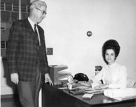 Dean H. Goard; Principal and woman seated at desk