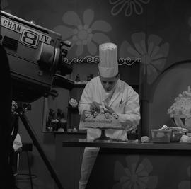 BCVS at Channel 8 TV; television set where a chef is decorating an Easter cake