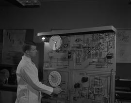 Instrumentation, 1966; man in a lab coat using circuit testing equipment