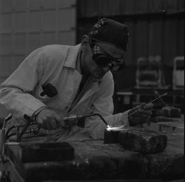 Welding, 1968; man wearing protective goggles welding [3 of 6]