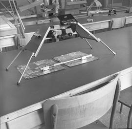 BCIT Programs Forestry Technology ; tilted stereoscope with tilted viewing assembly, maps, measur...