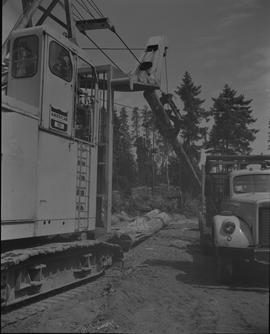 Log Loading, Nanaimo campus, 1967;  log loader moving a log onto a truck