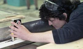 BCIT Women in Trades; carpentry, woman with measuring tape [2 of 2 photographs]