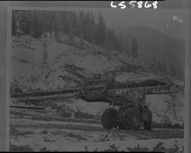 Logging, 1968; copy negative; picture of log loader carrying logs