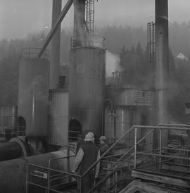 Forestry, Wood fiber BCIT tour, November 26, 1965; men wearing hard hats on a walkway on the roof...