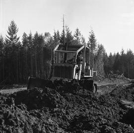Heavy duty equipment operator, Nanaimo ; man operating a bulldozer moving dirt [8 of 9]