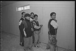 Coast Salish youths using power tools during gym construction [6 of 8 photographs]
