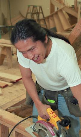 First Nations student wearing a tool belt and using a woodworking tool [7 of 13 photographs]