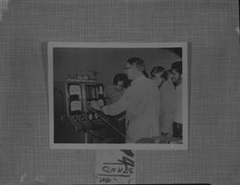 Automotive mechanical repair, ca. 1966; students and instructor using an electronic engine tester