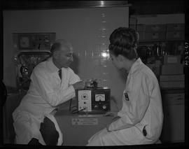 Medical isotope option, Health technology, 1967; an instructor showing a student a portable elect...