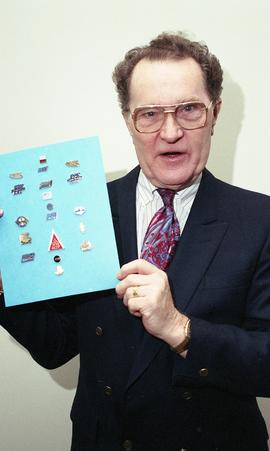 Kelly Gervais, Technology Centre, January 1995, man holding up board with pins on it [1 of 3 phot...