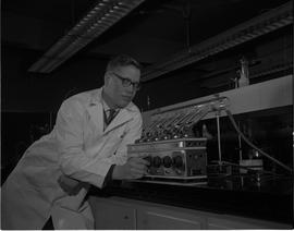 Food Processing Technology, 1966; man in a lab coat using food processing equipment [2 of 2]