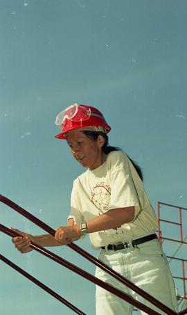 Pre-trade Aboriginal women; wearing hard hats and piecing together equipment [7 of 13 photographs]