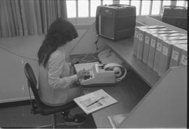 Pacific Vocational Institution ; student sitting at a desk using a calculator