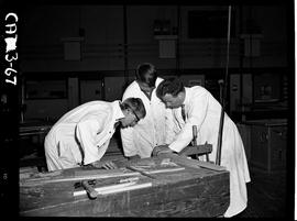 B.C. Vocational School image of a Carpentry Trades instructor teaching two students at a work ben...
