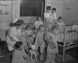 Nursing, 1967; three nurses having story hour with a group of children [1 of 2]