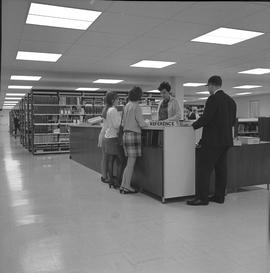 BCIT Library ; library and group of people at reference desk [1 of 2] [cont. in note]