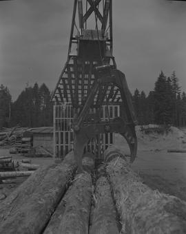 Log Loading, Nanaimo campus, 1967;  front view of a log loader