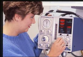 BCIT School of Health Sciences, nurse with monitoring device, ca. 1987 [1 of 2 photographs]