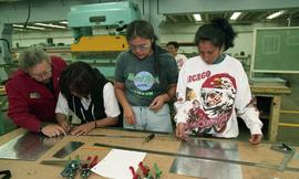 Pre-trade Aboriginal women; sheet metal, students and instructor in class [4 of 12 photographs]