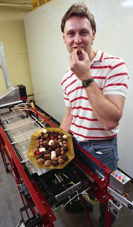 Gordon Thiessen, Chocolate Factory for Technology Centre, man posing with machine, chocolates [4 ...