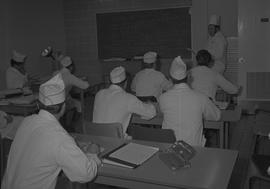 Tow boat cook course; instructor lecturing; students sitting at desks