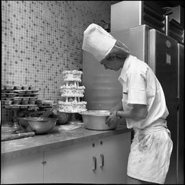 BC Vocational School Cook Training Course ; student hand mixing something in a bowl ; a decorated...