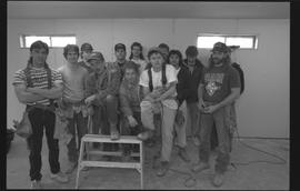 Students holding power tools and posing for a group shot during gym construction [2 of 8 photogra...