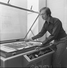 BCVS Graphic arts ; man placing a poster in a Nuarc plate maker