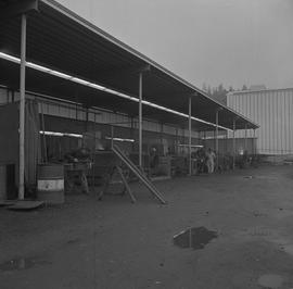 Welding, Nanaimo, 1968; work yard; welders working under a covered area [1 of 2]