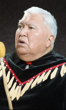Bob George, First Nations elder, in First Nations garment playing an instrument [33 of 36 photogr...