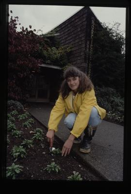 Horticulture 1990, female student outside Horticulture building