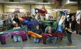 BCIT women in trades; fender, students holding painted car fenders inside a shop [5 of 9 photogra...
