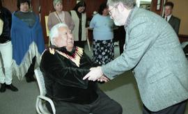 BCIT open house '98, First Nations elder shaking hands with a staff member [1 of 3 photographs]