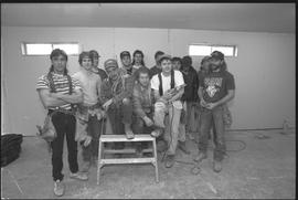 Students holding power tools and posing for a group shot during gym construction [6 of 8 photogra...
