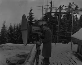 BCIT Broadcast and Television, 1964; man adjusting the settings on a satellite dish located on a ...