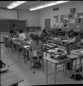 BC Vocational School Commercial Program; instructor writing on the chalkboard ; students using sh...