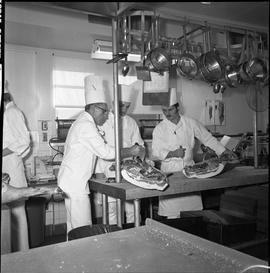BC Vocational School Cook Training Course ; instructor demonstrating how to butcher meat ; two st...